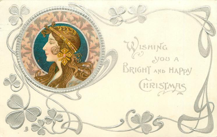 **WISHING YOU  A BRIGHT AND HAPPY CHRISTMAS  head upper left, brown & pink decorations round head, head piece with dangling ornament. she faces & looks left