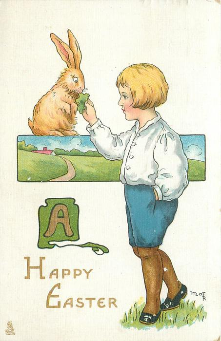 A HAPPY EASTER  boy feeds a leaf to brown rabbit