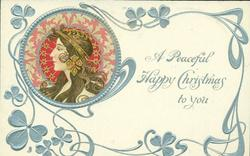 **A PEACEFUL HAPPY CHRISTMAS TO YOU  head upper left, brown & pink decorations round head, head piece with dangling ornament. she faces & looks left