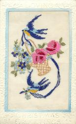 LOVING CHRISTMAS GREETINGS  silk two birds with ribbon in their beak with wicker basket of flowers, two roses & forget-me-nots