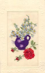 A HAPPY NEW YEAR  silk purple jug with forget-me-nots, three red roses on ground