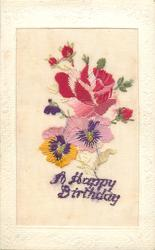 A HAPPY BIRTHDAY  in purple, roses above pansies, one violet