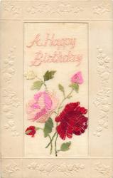 A HAPPY BIRTHDAY  in pink, two roses (pink, red) and two buds (pink, red)