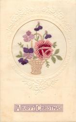 A HAPPY CHRISTMAS  in purple, wicker basket inset with handle, pink rose right, purple&pink pansies