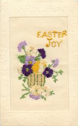 EASTER JOY  in yellow, wicker basket with purple, white pansies
