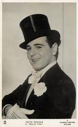 "FRITZ SHULZ IN ""WALTZ TIME""  wears high black hat, white bow tie, gloves"