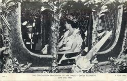 close-up view of Queen seated in coach