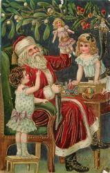 CHRISTMAS GREETINGS Santa shows two girls a doll