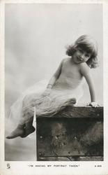 """I'M HAVING MY PORTRAIT TAKEN.""  young girl in sheer wrap sitting on ledge"