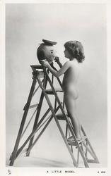 A LITTLE MODEL  nude young girl on stepladder holds humpty dumpty