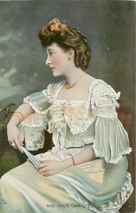 MISS GRACE LANE  head & shoulders study, fan held between both hands, facing & looking slightly left