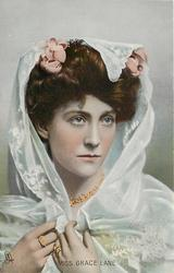 MISS GRACE LANE  head & shoulders study, with lace shawl over head & shoulders held with both hands