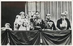 T.R.H. THE DUKE & DUCHESS OF KENT ACKNOWLEDGING THE OVATION OF THE POPULACE FROM THE BALCONY OF BUCKINGHAM PALACE AFTER THEIR WEDDING, NOVEMBER 29TH, 1934... NOVEMBER 29TH, 1934
