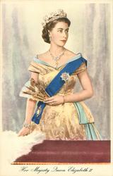 HER MAJESTY QUEEN ELIZABETH II  standing on balcony holding fan