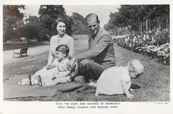 T.R.H. THE DUKE AND DUCHESS OF EDINBURGH WITH PRINCE CHARLES AND PRINCESS ANNE sitting in a park