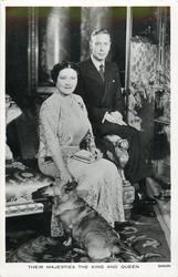 THEIR MAJESTIES THE KING AND QUEEN  with small dog (Welsh Corgi)