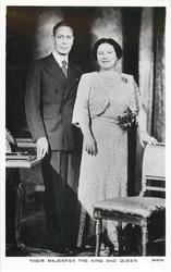 THEIR MAJESTIES THE KING AND QUEEN  both standing, looking & facing front, she is right