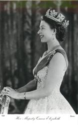 HER MAJESTY QUEEN ELIZABETH  smiling fully, facing & looking left