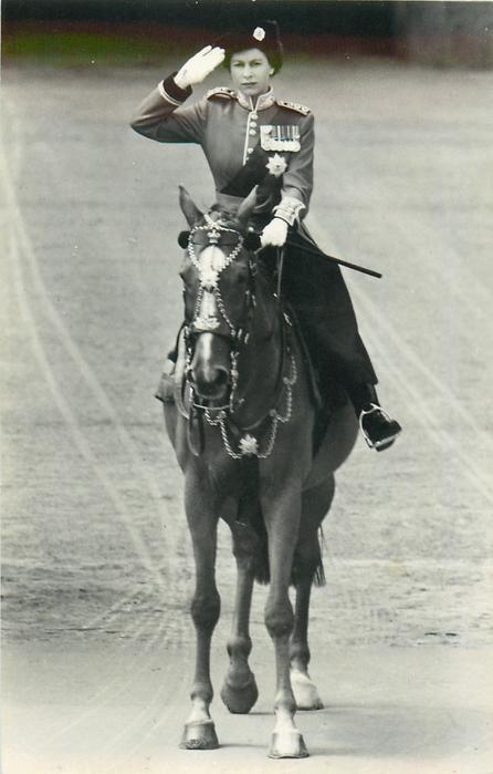 Queen Elizabeth II in uniform salutes on horseback