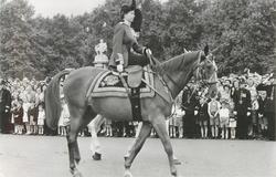 Queen Elizabeth II in uniform rides right