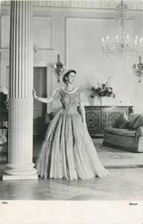 Queen Elizabeth II with right hand on column