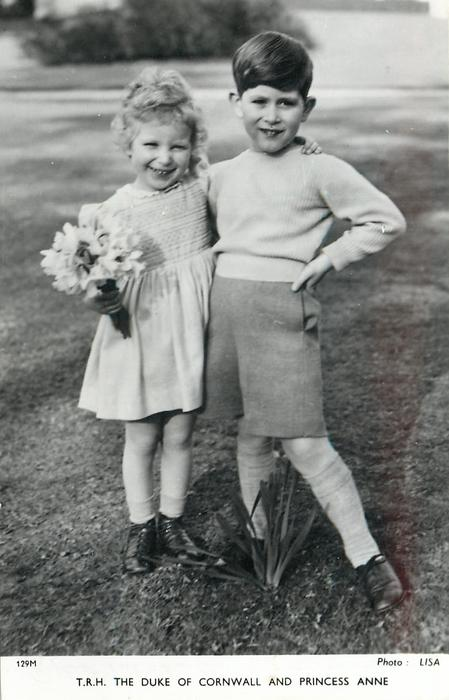 T.R.H.THE DUKE OF CORNWALL AND PRINCESS ANNE  standing with arms round each other