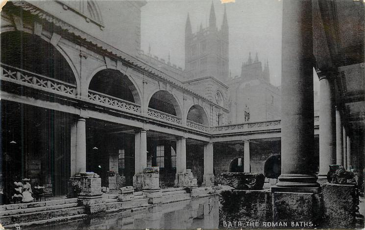 THE ROMAN BATHS  woman wearing hat sits on left, prominent pillars right