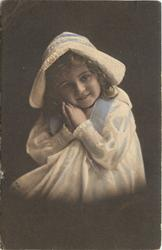 young girl in bonnet & dress sits facing half left, looking forward, hands touching her right cheek
