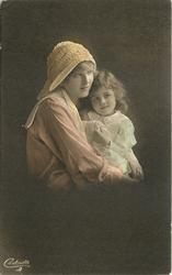 mother holds daughter, her left hand shows ring, only left hand of child is visible