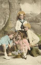 untitled: three boys & a smaller girl sit posed with a fake tree, basket of flowers held  by the girl with both hands as she looks through the handle