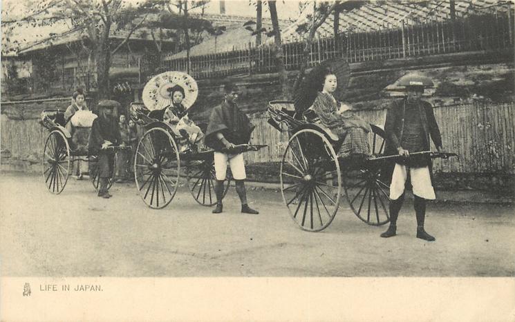 three rickshaws, each with geisha sitting in them