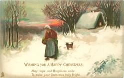 WISHING YOU A HAPPY CHRISTMAS woman in red cape and white hat, walks left in snow, dog behind, house further behind