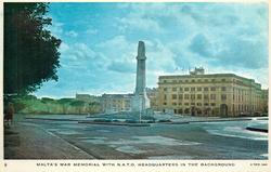 MALTA'S WAR MEMORIAL WITH N.A.T.O. HEADQUARTERS IN THE BACKGROUND