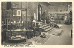 VIEW OF EXHIBITS AND CARVED OFFICE  prominent exhibition case, man descending stair