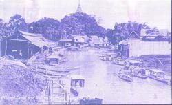 KLONGI CANAL AND NATIVE HOUSES