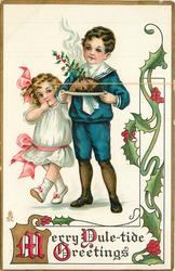 A MERRY YULE-TIDE GREETINGS  boy in blue, girl in white carry pudding on plate