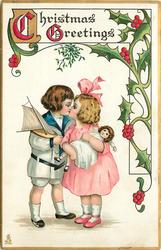CHRISTMAS GREETINGS  boy carrying toy yacht kisses girl carrying doll