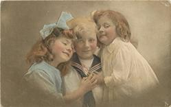 boy in sailor suite between two girls, both girls have hands high on boys chest covering the knot on his tie, anchor shows on boys shirt, boy looks front