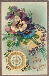 bunch & horseshoe of pansies above  clock