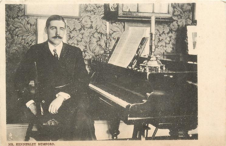 MR. KENNERLEY RUMFORD  sitting at piano