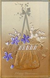 A HAPPY CHRISTMAS  embossed inserts of violets & lilies of the valley & purple ribbon