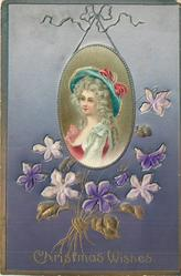 CHRISTMAS WISHES  appliqued medallion insert hung from above of pretty girl, insets of violets below