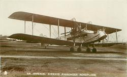 AN IMPERIAL AIRWAYS PASSENGER AEROPLANE  PRINCE GEORGE (on aircraft), on airfield, facing right/front , back of plane obscured by wing