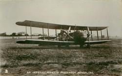 AN IMPERIAL AIRWAYS PASSENGER AEROPLANE  aircraft  on airfield, bulbous nose,  facing right/front, 2 propellers 4 blades, 4 wheels