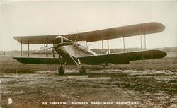 AN IMPERIAL AIRWAYS PASSENGER AEROPLANE  no name on aircraft  on airfield, facing left/front, single propeller 2 blades