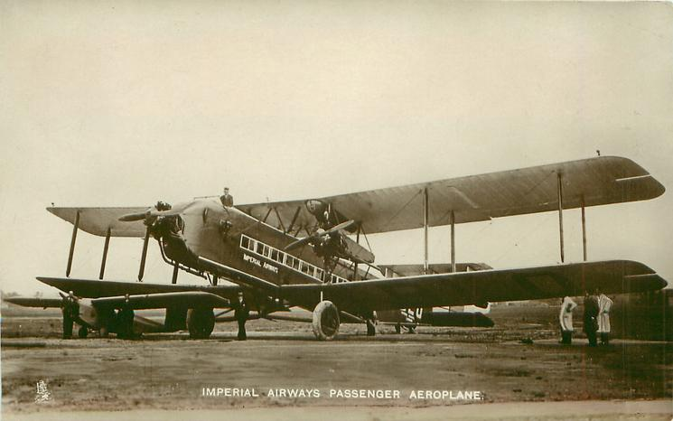 IMPERIAL AIRWAYS PASSENGER AEROPLANE  aircraft on airfield, long nose with extra propeller, facing left/front, 3 propellers 2 blades