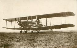 IMPERIAL AIRWAYS PASSENGER AEROPLANE  no name on aircraft  on airfield, facing left/front, 2 propellers 2 blades, 4 front wheels