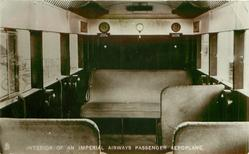 INTERIOR OF AN IMPERIAL AIRWAYS PASSENGER AEROPLANE  close up of cloth seats looking back