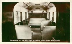INTERIOR OF AN IMPERIAL AIRWAYS PASSENGER AEROPLANE  mid-distant view of cloth seats looking back
