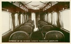 INTERIOR OF AN IMPERIAL AIRWAYS PASSENGER AEROPLANE  wicker seats looking back